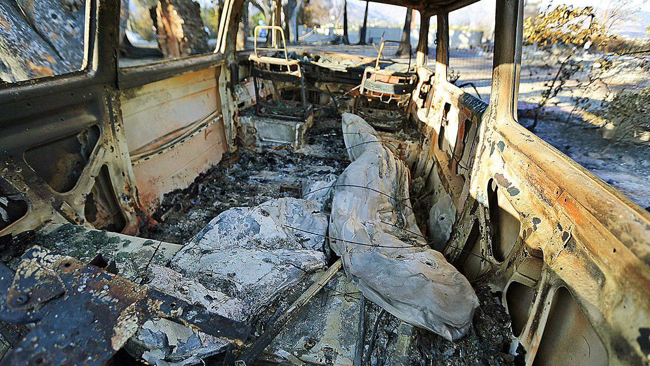 <div class='meta'><div class='origin-logo' data-origin='none'></div><span class='caption-text' data-credit='Reed Saxon/AP Photo'>Surfboards are seen inside a destroyed Volkswagen van at a home destroyed by the Woolsey fire on Dume Drive in the Point Dume area of Malibu in Southern California Tuesday, Nov. 13</span></div>