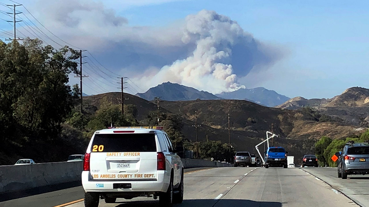 <div class='meta'><div class='origin-logo' data-origin='none'></div><span class='caption-text' data-credit='Amanda Myers/AP Photo'>A large wildfire plume from a recent flareup near Lake Sherwood, Calif., is visible from Highway 101 north of Los Angeles, Tuesday, Nov. 13, 2018.</span></div>