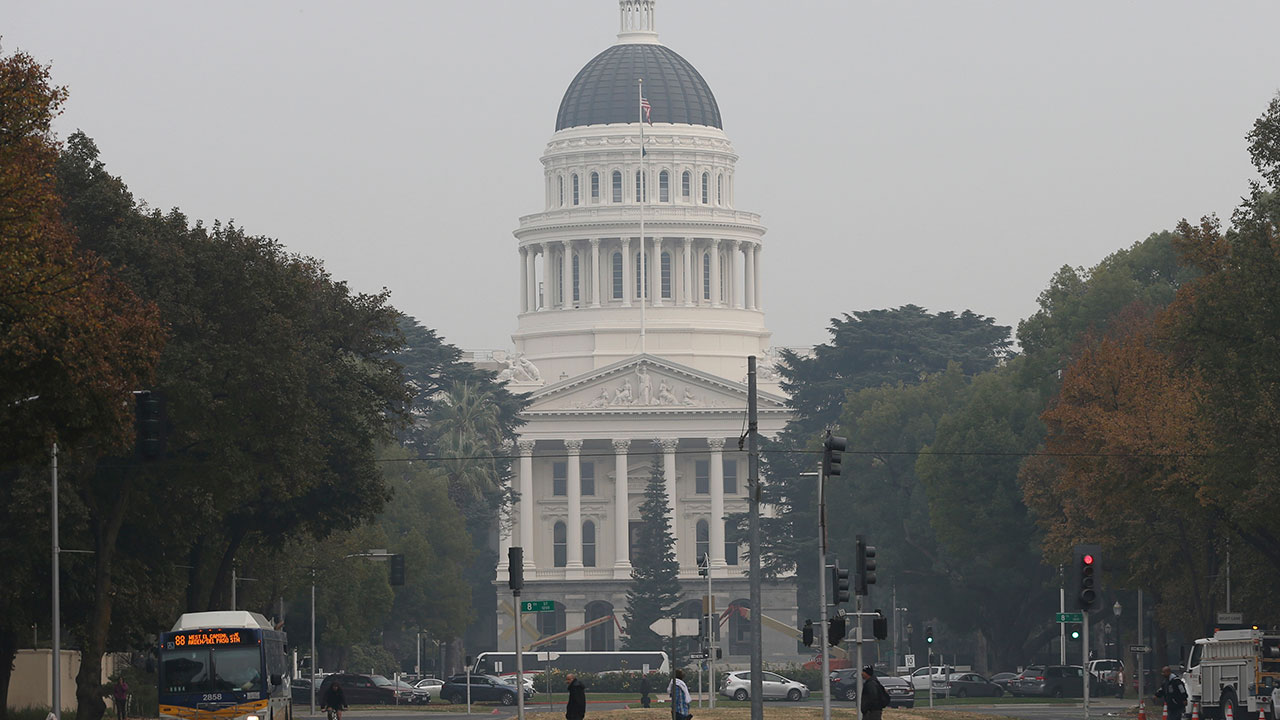 <div class='meta'><div class='origin-logo' data-origin='none'></div><span class='caption-text' data-credit='Rich Pedroncelli/AP Photo'>The California state Capitol is viewed through the smoke from the Camp Fire, Tuesday, Nov. 13, 2018, in Sacramento, Calif.</span></div>