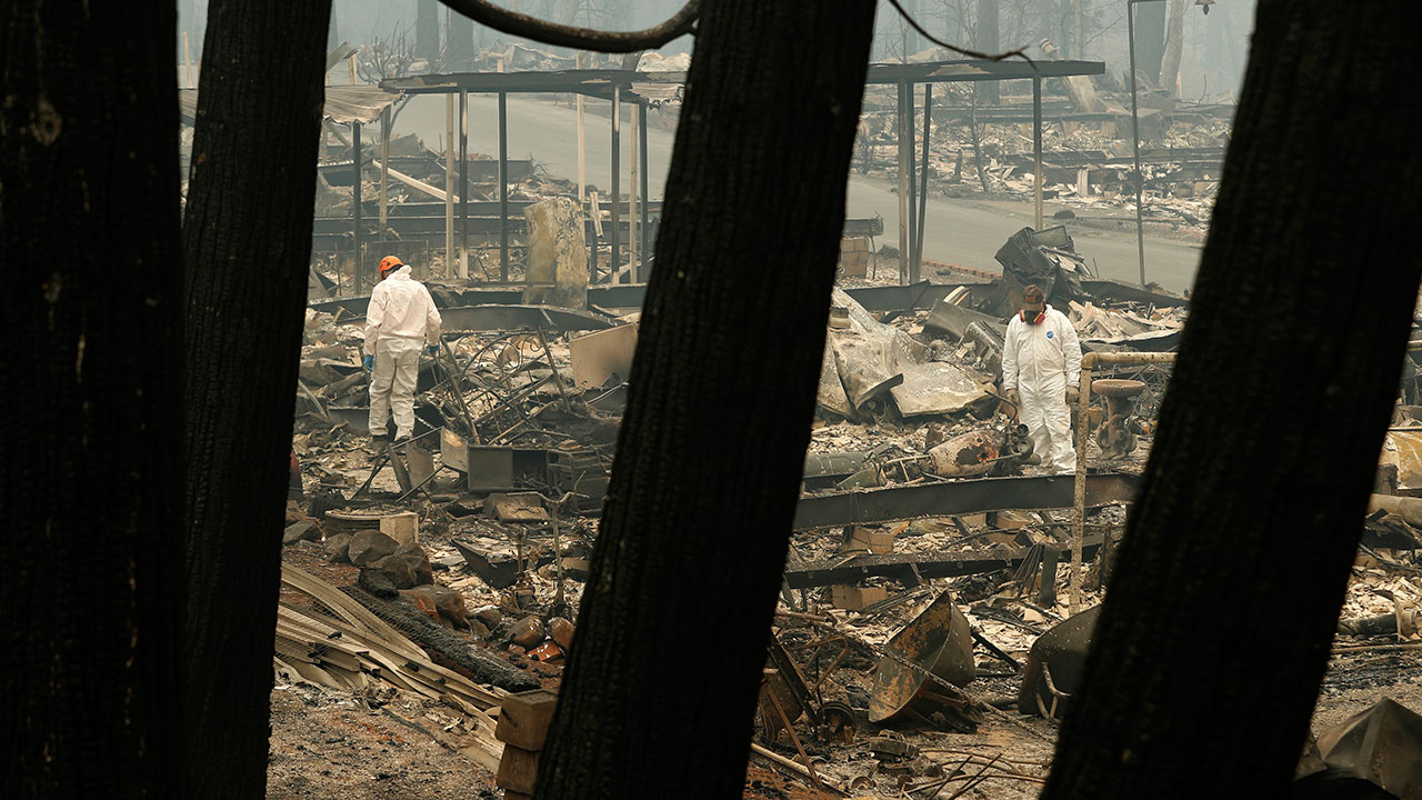<div class='meta'><div class='origin-logo' data-origin='none'></div><span class='caption-text' data-credit='John Locher/AP Photo'>A search and rescue workers search for human remains at a burned out trailer park from the Camp fire, Tuesday, Nov. 13, 2018, in Paradise, Calif.</span></div>