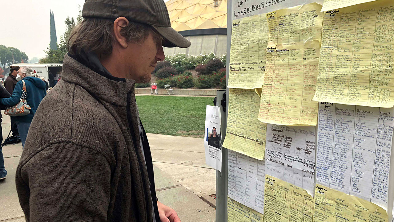 <div class='meta'><div class='origin-logo' data-origin='none'></div><span class='caption-text' data-credit='Gillian Flaccus/AP Photo'>Wildfire evacuee Greg Gibson looks for information about his missing neighbors at The Neighborhood Church in Chico, Calif., on Tuesday, Nov. 13, 2018.</span></div>