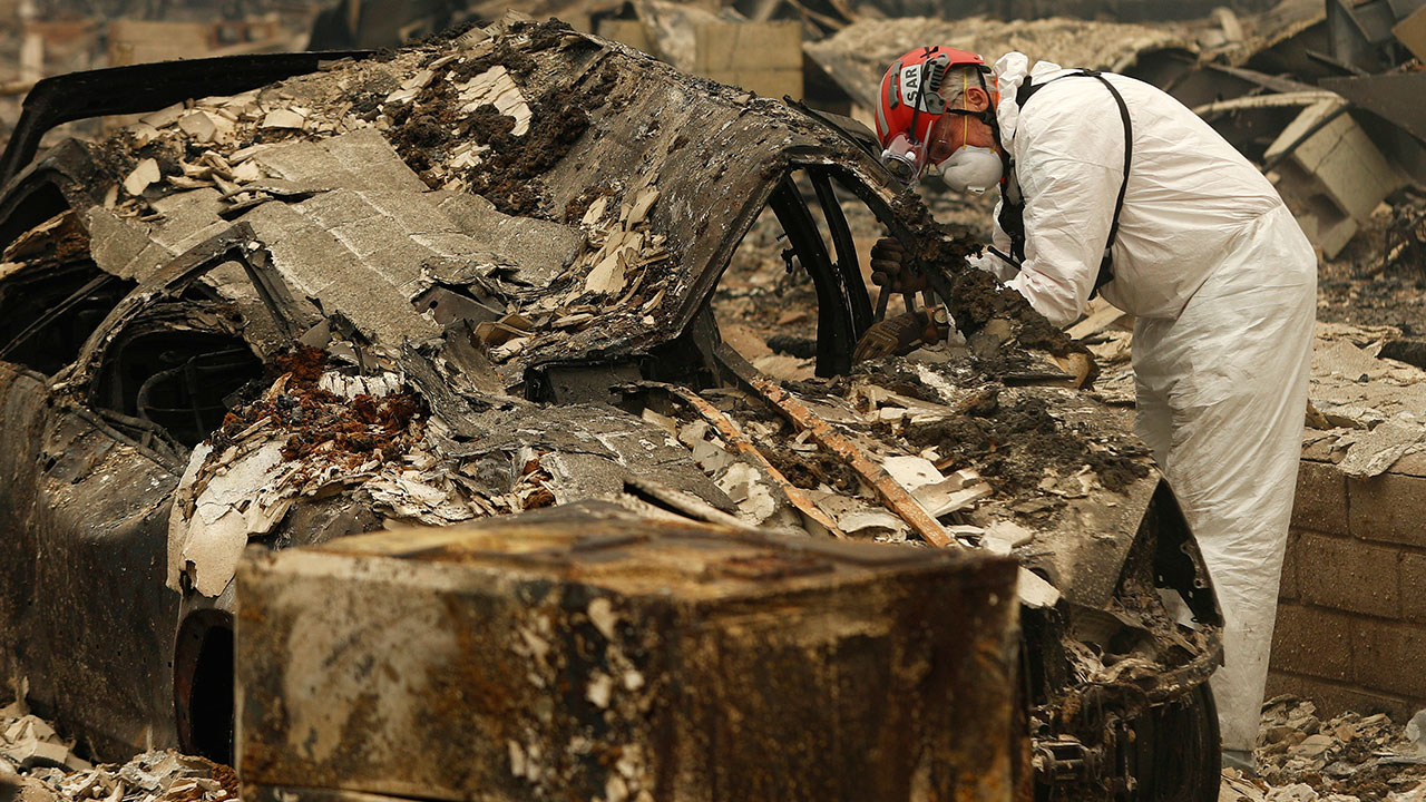 <div class='meta'><div class='origin-logo' data-origin='none'></div><span class='caption-text' data-credit='John Locher/AP Photo'>A search and rescue workers searches a car for human remains at a trailer park burned out from the Camp Fire, Tuesday, Nov. 13, 2018, in Paradise, Calif.</span></div>