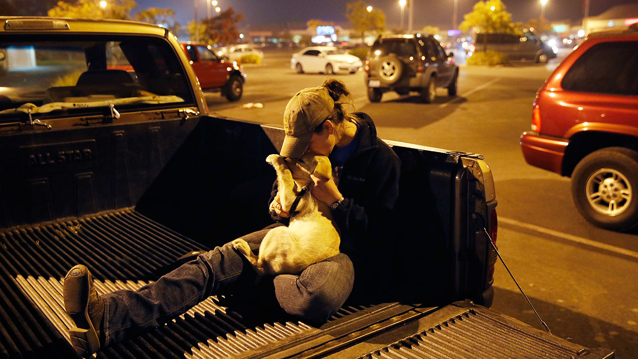 <div class='meta'><div class='origin-logo' data-origin='none'></div><span class='caption-text' data-credit='John Locher/AP Photo'>Sarah Gronseth kisses her dog Branch after losing her home on Tuesday, Nov. 13, 2018, in Chico Calif. Gronseth, a teacher, evacuated some of her high school students in her truck.</span></div>