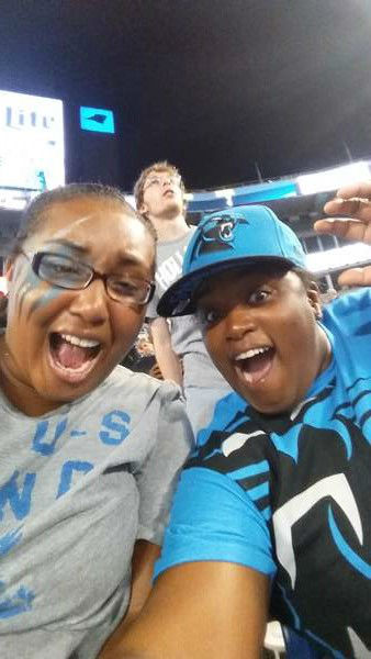 "<div class=""meta image-caption""><div class=""origin-logo origin-image ""><span></span></div><span class=""caption-text"">Johnna and Allison cheer on the Panthers. (Johnna/iWitness photo)</span></div>"