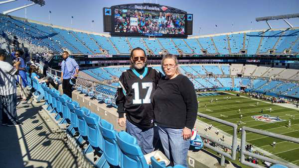 """<div class=""""meta image-caption""""><div class=""""origin-logo origin-image """"><span></span></div><span class=""""caption-text"""">""""My wife and I at the Seahawks - Panthers game on Oct 26th shortly after my last chemo session and as of this writing I'm still cancer free."""" (Robert Murphy/iWitness photo)</span></div>"""