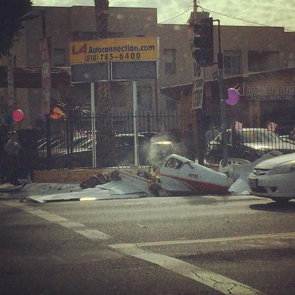 "<div class=""meta image-caption""><div class=""origin-logo origin-image ""><span></span></div><span class=""caption-text"">An ABC7 viewer captures the wreckage of the small single-engine plane that crashed in an intersection in Lake Balboa on Friday, Jan. 9, 2015. (twitter.com/sharonmashal)</span></div>"