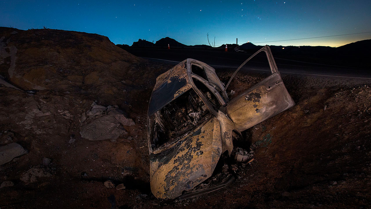 <div class='meta'><div class='origin-logo' data-origin='none'></div><span class='caption-text' data-credit='DAVID MCNEW/AFP/Getty Images'>A burned car is seen crashed off the side of Mulholland Highway at night in the Santa Monica Mountains in the aftermath of the Woolsey Fire on November 14, 2018 near Malibu.</span></div>