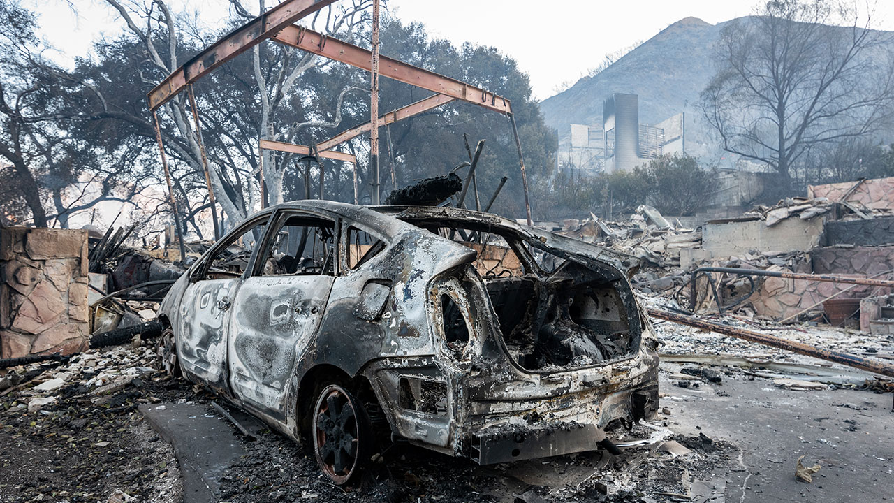 <div class='meta'><div class='origin-logo' data-origin='none'></div><span class='caption-text' data-credit='Ronen Tivony/NurPhoto via Getty'>A car destroyed by the Woolsey Fire near Malibu, California on November 12, 2018.</span></div>