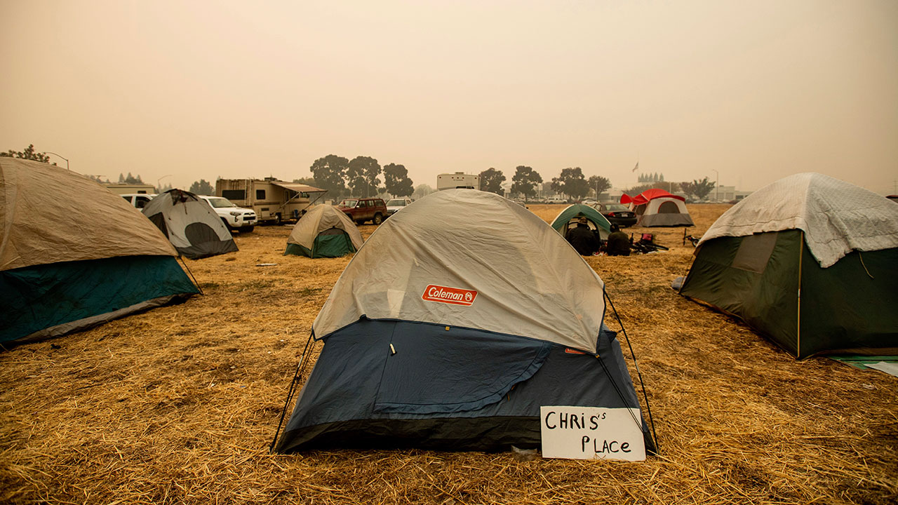 <div class='meta'><div class='origin-logo' data-origin='none'></div><span class='caption-text' data-credit='Noah Berger/AP Photo'>A sign hangs beside a tent at a makeshift shelter for evacuees of the Camp Fire in Chico, Calif., on Wednesday, Nov. 14, 2018.</span></div>