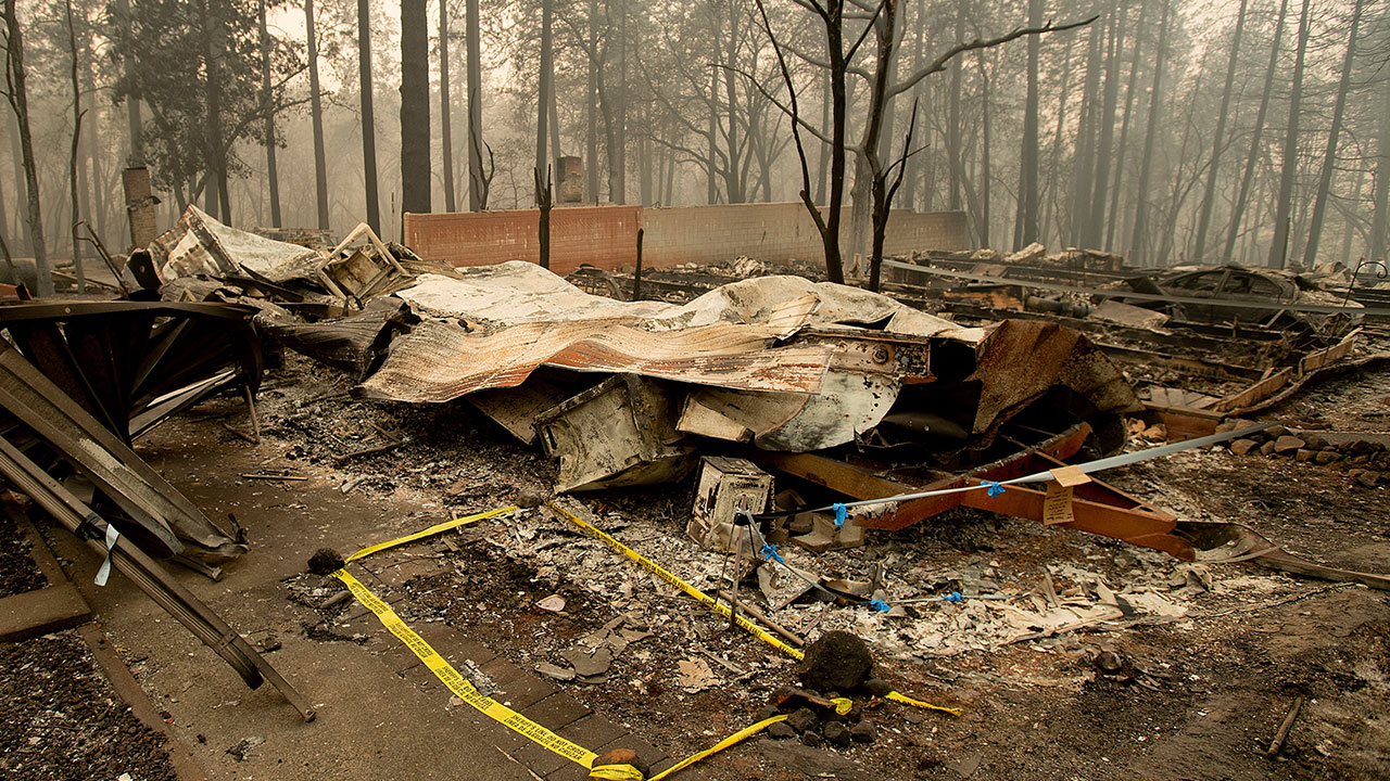 <div class='meta'><div class='origin-logo' data-origin='none'></div><span class='caption-text' data-credit='Noah Berger/AP Photo'>Tape marks a spot where sheriff's deputies recovered the body of a Camp Fire victim on Wednesday, Nov. 14, 2018, in Paradise, Calif.</span></div>
