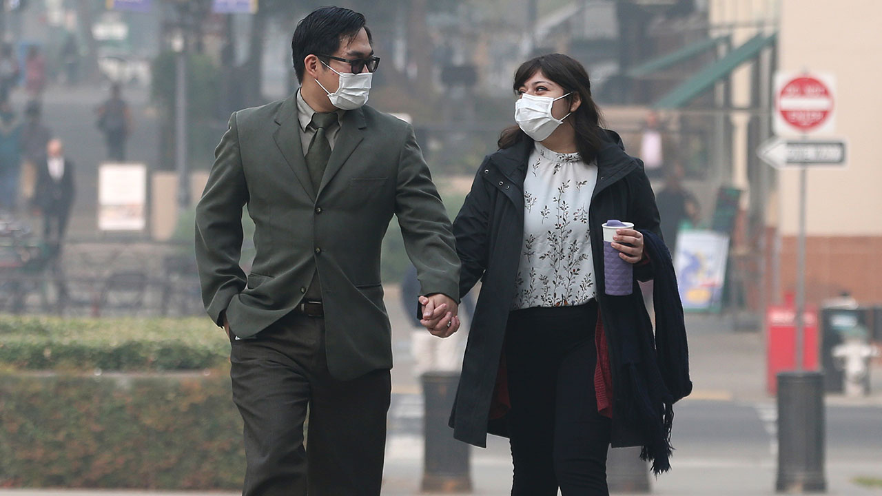 <div class='meta'><div class='origin-logo' data-origin='none'></div><span class='caption-text' data-credit='Rich Pedroncelli/AP Photo'>Tashi Nacario and Samantha Salas don masks to deal with the smoke from the Camp Fire that shrouds the state Capitol Thursday, Nov. 15, 2018, in Sacramento, Calif.</span></div>