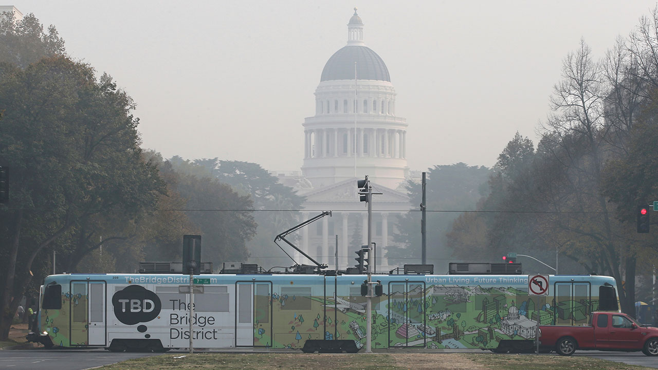 <div class='meta'><div class='origin-logo' data-origin='none'></div><span class='caption-text' data-credit='Rich Pedroncelli/AP Photo'>A light-rail train passes in front of the smoke shrouded state Capitol Thursday, Nov. 15, 2018, in Sacramento, Calif.</span></div>