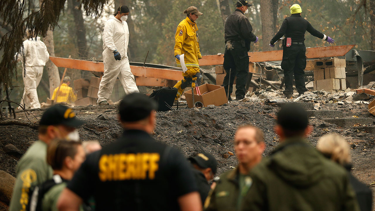 <div class='meta'><div class='origin-logo' data-origin='none'></div><span class='caption-text' data-credit='John Locher/AP Photo'>Investigators recover human remains at a home burned in the Camp Fire, Thursday, Nov. 15, 2018, in Magalia, Calif.</span></div>