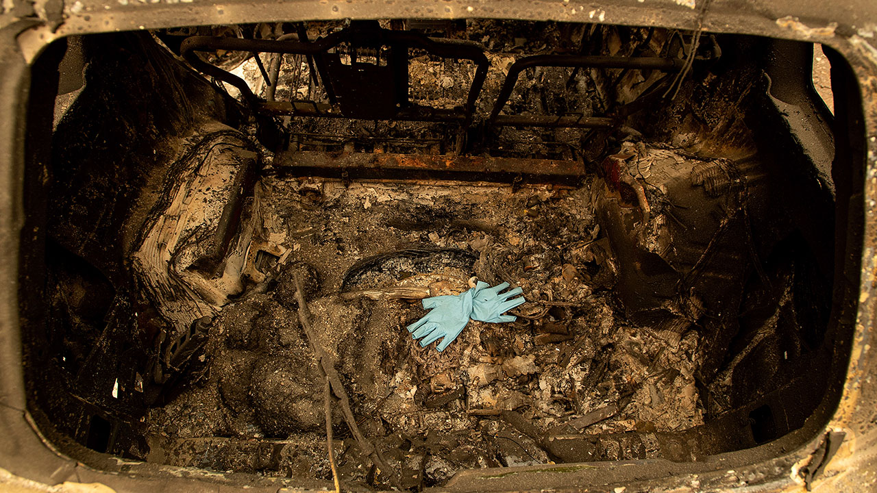 <div class='meta'><div class='origin-logo' data-origin='none'></div><span class='caption-text' data-credit='Noah Berger/AP Photo'>Gloves rest in a scorched car after the Camp Fire burned through Paradise, Calif., on Thursday, Nov. 15, 2018.</span></div>