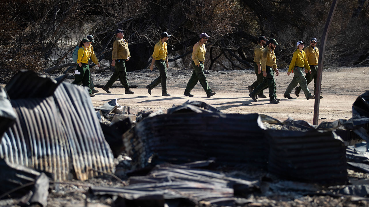 <div class='meta'><div class='origin-logo' data-origin='none'></div><span class='caption-text' data-credit='Jae C. Hong/AP Photo'>Firefighters walk arrive at decimated Paramount Ranch for a meeting with U.S. Secretary of the Interior Ryan Zinke Thursday, Nov. 15, 2018, in Agoura Hills, Calif.</span></div>