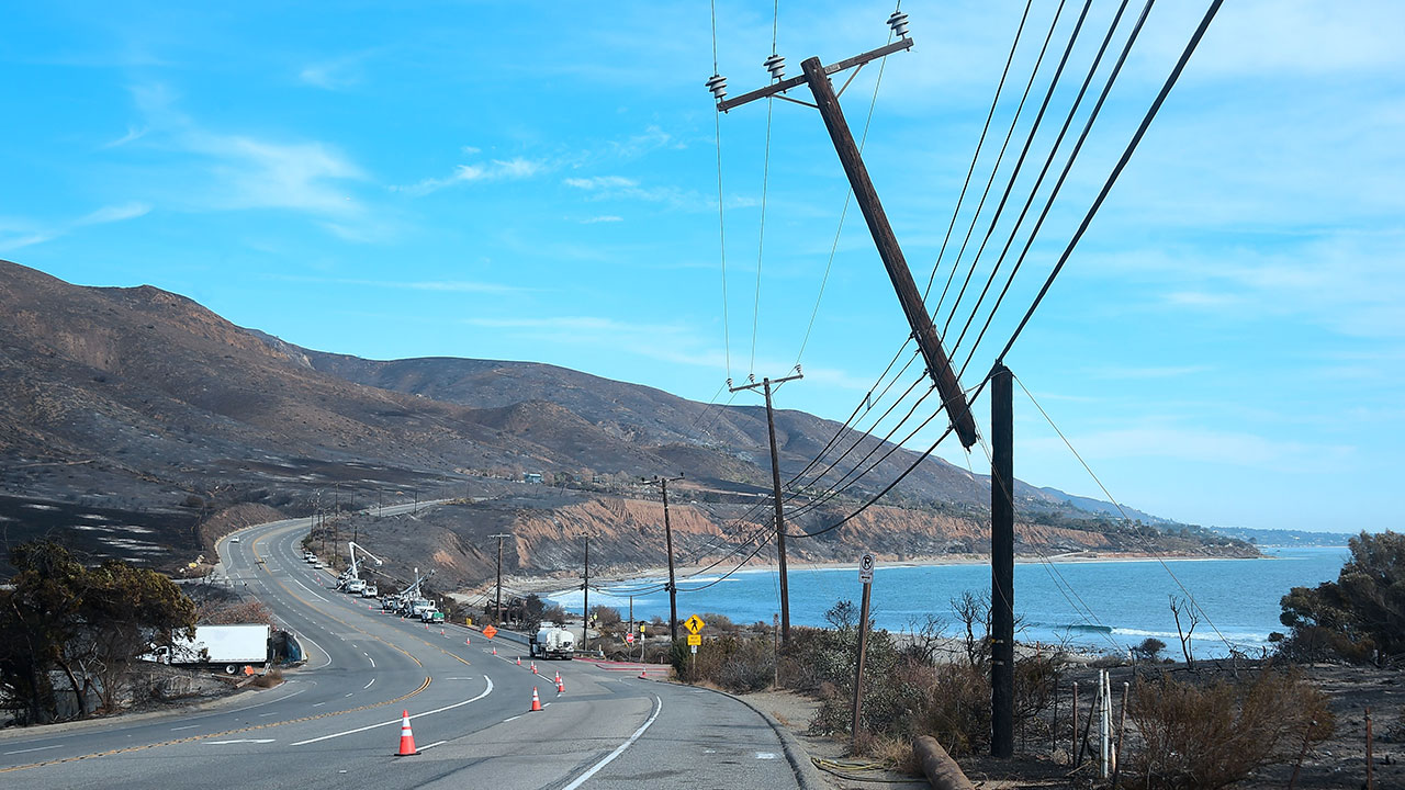 <div class='meta'><div class='origin-logo' data-origin='none'></div><span class='caption-text' data-credit='FREDERIC J. BROWN/AFP/Getty Images'>Power lines are repaired along the Pacific Coast Highway amid the blackened and charred hills from the Woolsey Fire in Malibu, California on November 15, 2018.</span></div>