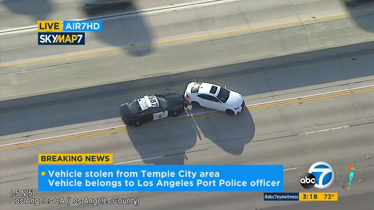 Suspect in officer's stolen car flees police at high speeds