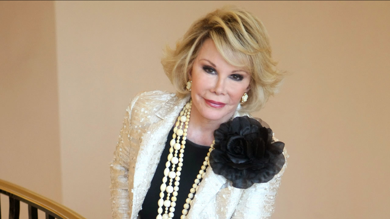 """This Oct. 5, 2009, file photo shows Joan Rivers posing as she presents """"Comedy Roast with Joan Rivers """" during the 25th MIPCOM in Cannes, France."""