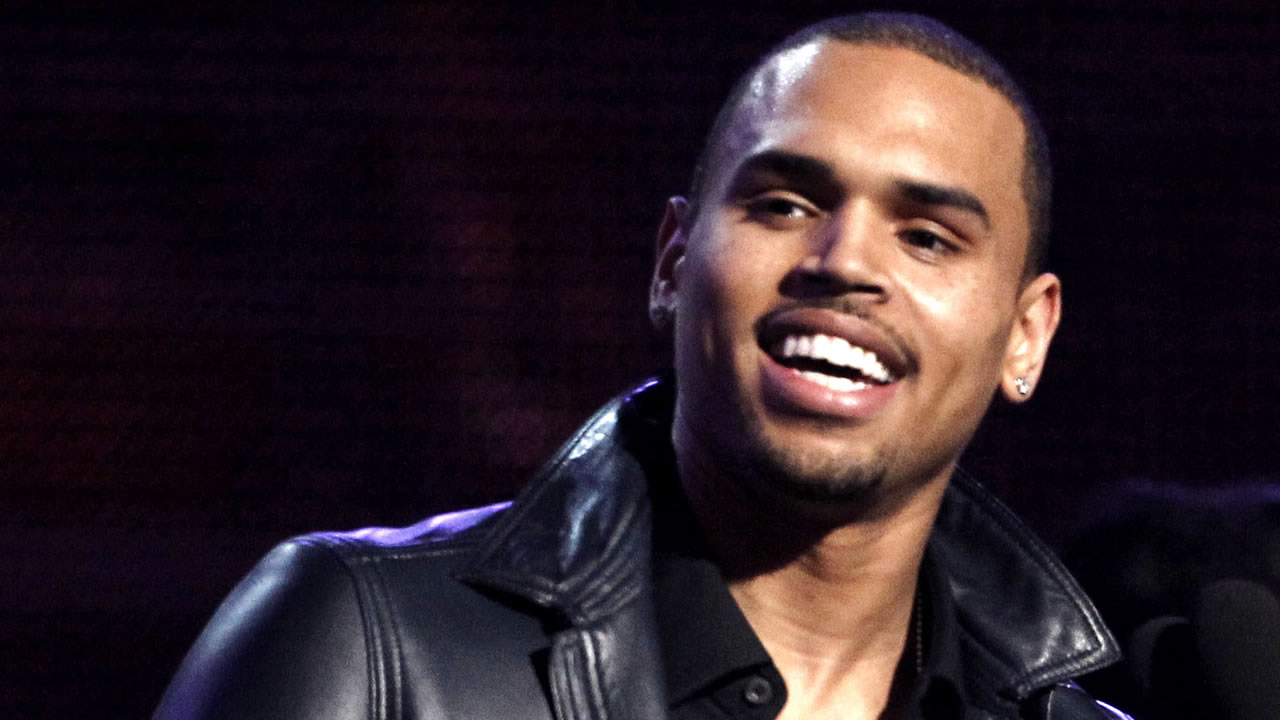 "Chris Brown accepts the award for best R&B album for ""F.A.M.E."" during the 54th annual Grammy Awards on Sunday, Feb. 12, 2012 in Los Angeles."