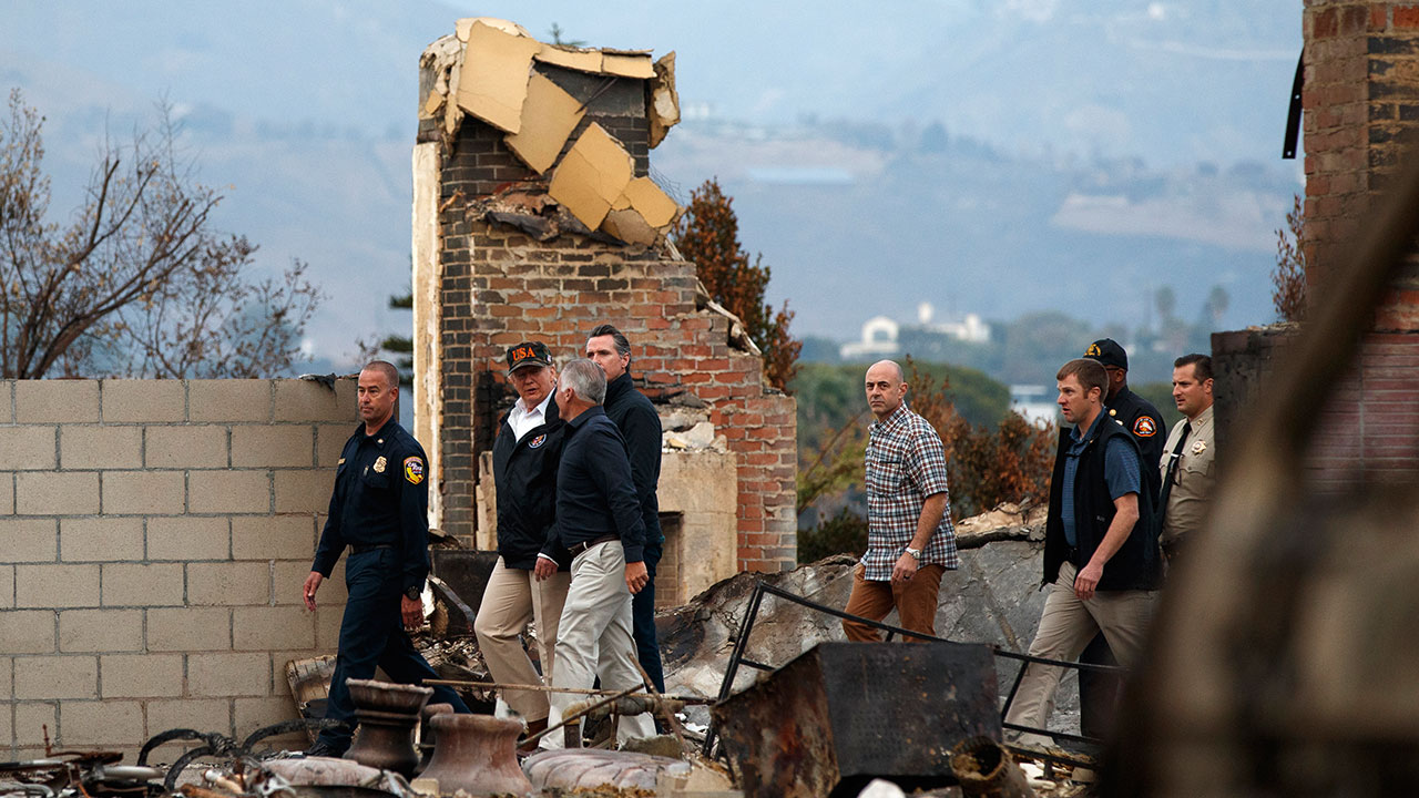 <div class='meta'><div class='origin-logo' data-origin='none'></div><span class='caption-text' data-credit='Evan Vucci/AP Photo'>President Donald Trump visits a neighborhood impacted by the Woolsey Fire, Saturday, Nov. 17, 2018, in Malibu, Calif.</span></div>