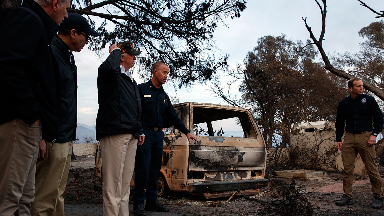 <div class='meta'><div class='origin-logo' data-origin='none'></div><span class='caption-text' data-credit='Evan Vucci/AP Photo'>President Donald Trump stands near a burned out vehicle as he visits a neighborhood impacted by the Woolsey Fire, Saturday, Nov. 17, 2018, in Malibu, Calif.</span></div>