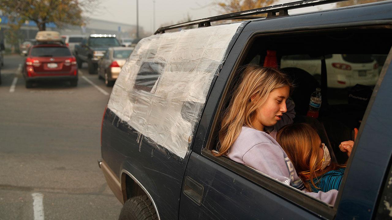 <div class='meta'><div class='origin-logo' data-origin='none'></div><span class='caption-text' data-credit='John Locher/AP Photo'>Dakota Keltner, right, rests on Havyn Cargill-Morris in a truck at a makeshift encampment outside a Walmart store on Friday, Nov. 16, 2018, in Chico, Calif.</span></div>