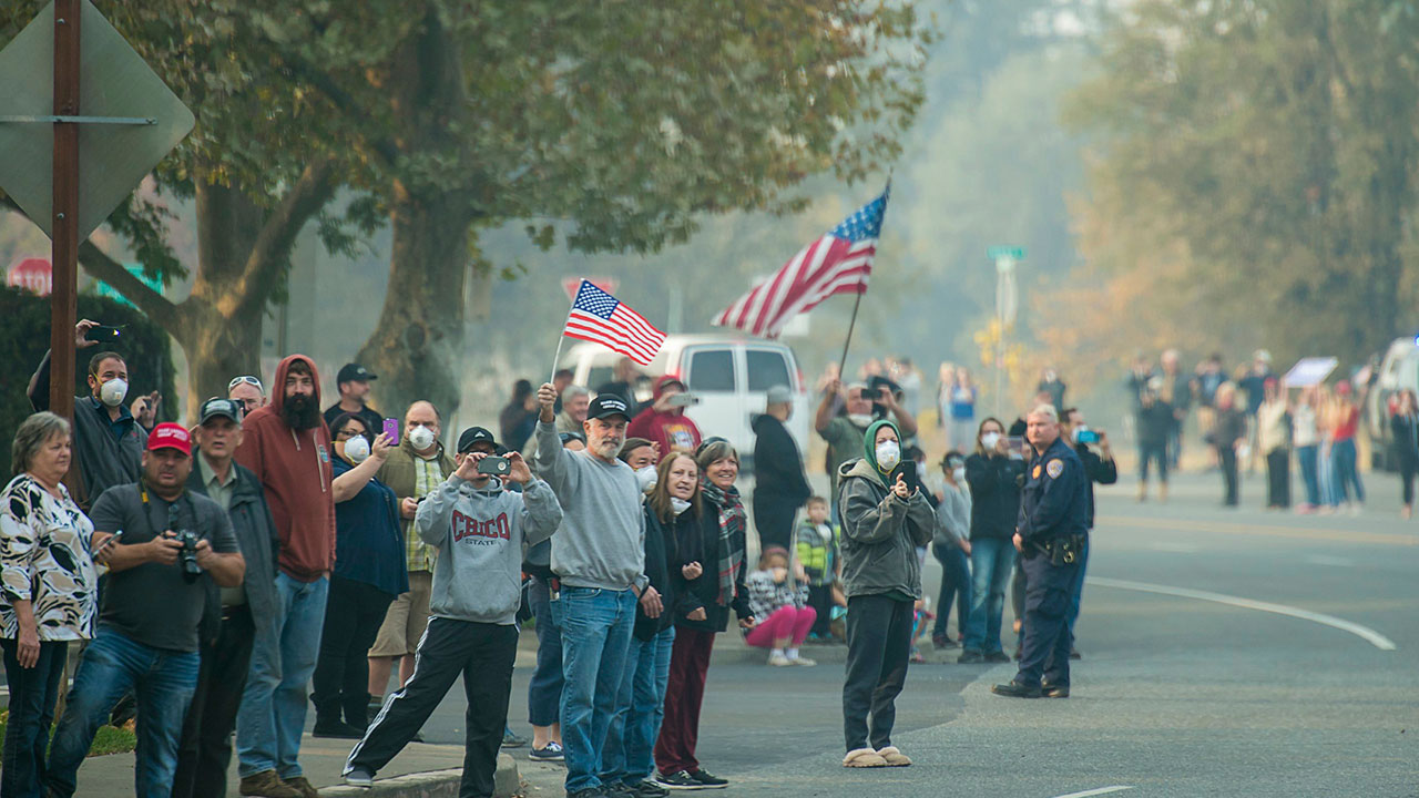 <div class='meta'><div class='origin-logo' data-origin='none'></div><span class='caption-text' data-credit='Paul Kitagaki Jr./Regional Pool/Sacramento Bee via AP'>Residents wave to the motorcade during President Donald Trump visit of the Camp Fire in Chico, Calif. on Saturday, November 17, 2018.</span></div>