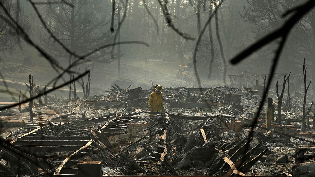 <div class='meta'><div class='origin-logo' data-origin='none'></div><span class='caption-text' data-credit='John Locher/AP Photo'>A firefighter searches for human remains in a trailer park destroyed in the Camp Fire, Friday, Nov. 16, 2018, in Paradise, Calif.</span></div>