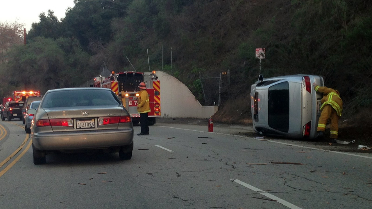 A car was overturned after it crashed into a telephone pole near Griffith Park on Monday, Jan. 12, 2015.