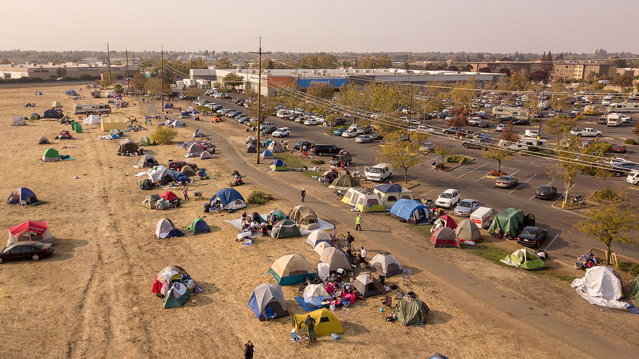 <div class='meta'><div class='origin-logo' data-origin='none'></div><span class='caption-text' data-credit='Josh Edelson for the Washington Post'>In this aerial photograph, an evacuee encampment is seen at a Walmart parking lot in Chico, California on November 19, 2018.</span></div>