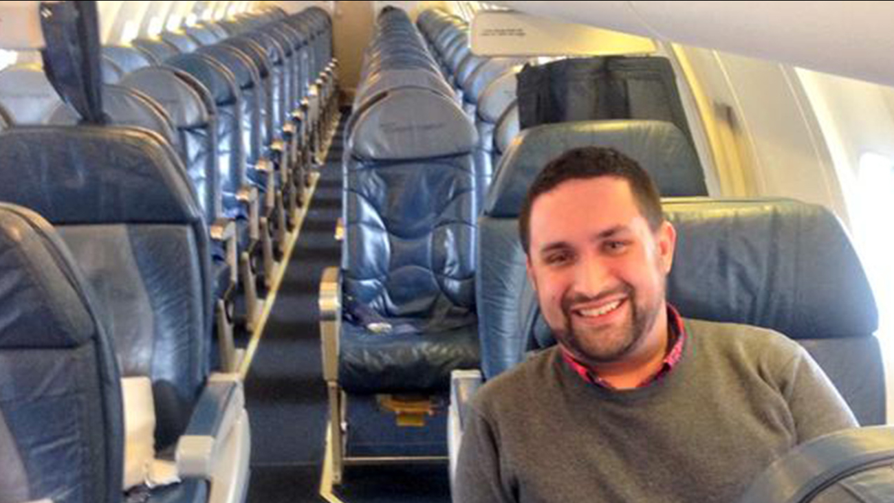 Chris O'Leary poses for a photo on an empty Delta Airlines flight on Monday, Jan. 12, 2015.