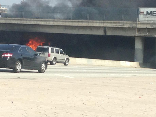 A big rig caught fire on the westbound 10 Freeway in East Los Angeles on Tuesday, Jan. 13, 2015.