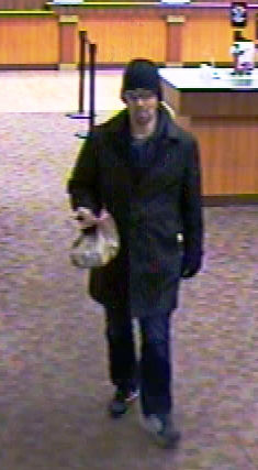 """<div class=""""meta image-caption""""><div class=""""origin-logo origin-image """"><span></span></div><span class=""""caption-text"""">Durham police are searching for the man who held up a BB&T bank Tuesday in Woodcroft. (WTVD Photo/ Durham Police Department)</span></div>"""
