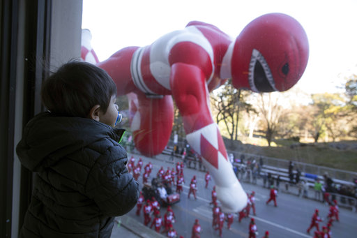 "<div class=""meta image-caption""><div class=""origin-logo origin-image none""><span>none</span></div><span class=""caption-text"">Hudson Garber, 2, watches the Red Mighty Morphin Power Ranger balloon floats by from the JW Marriott Essex House during the 92nd annual Macy's Thanksgiving Day Parade. (AP)</span></div>"