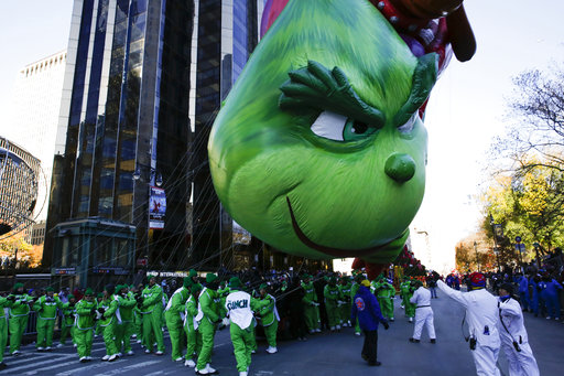 "<div class=""meta image-caption""><div class=""origin-logo origin-image none""><span>none</span></div><span class=""caption-text"">Performers fight to hold their position on The Grinch balloon as it floats over Central Park West during the 92nd annual Macy's Thanksgiving Day Parade in New York. (AP)</span></div>"