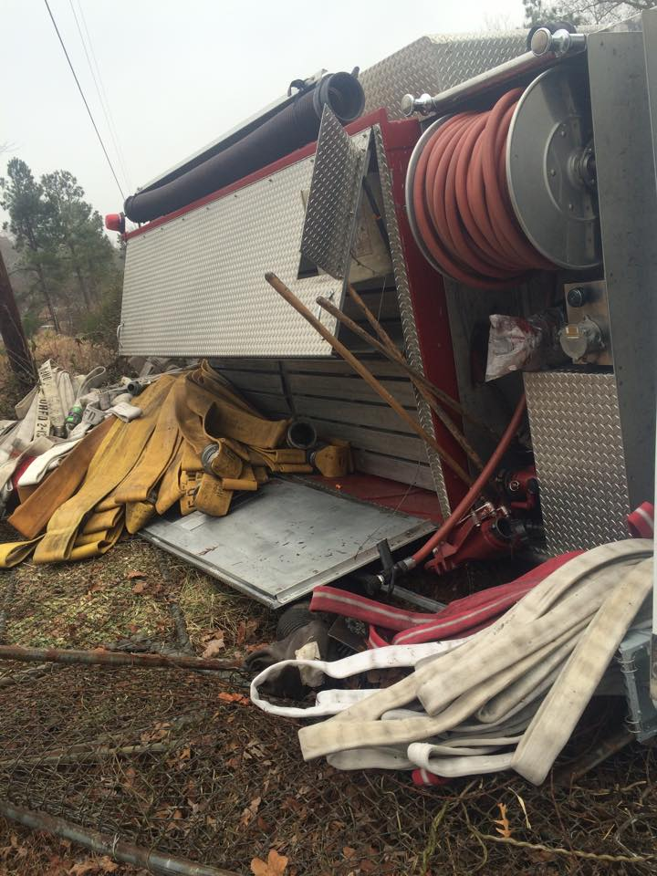 "<div class=""meta image-caption""><div class=""origin-logo origin-image ""><span></span></div><span class=""caption-text"">A fire truck flipped on its side in Orange County (photos courtesy of Austin Hall)</span></div>"