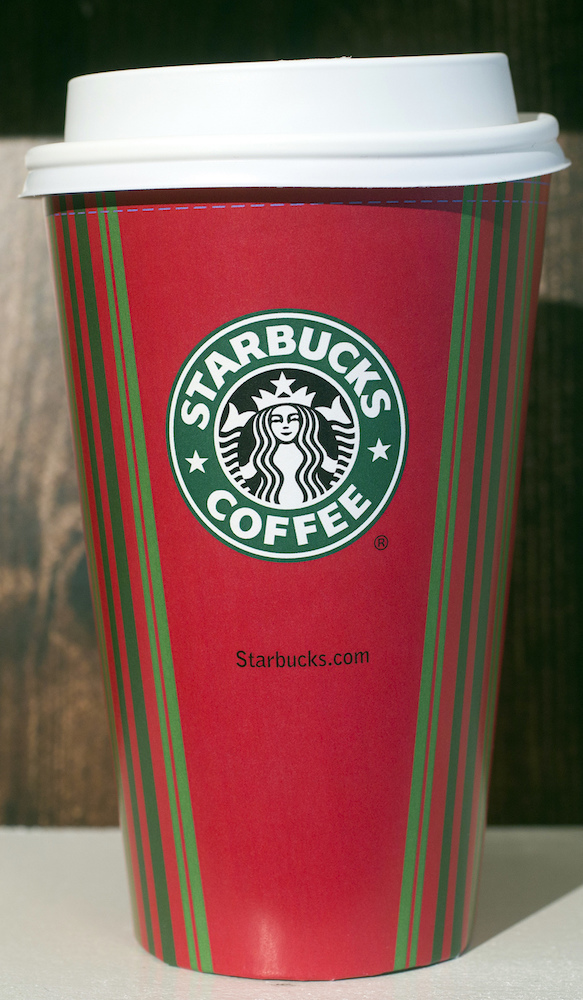 <div class='meta'><div class='origin-logo' data-origin='AP'></div><span class='caption-text' data-credit='AP Photo/Mark Lennihan'>A 2001 Starbucks holiday cup is displayed, Thursday, Nov. 9, 2017, at a Starbucks in New York. The Seattle-based company is celebrating 20 years of holiday coffee cups.</span></div>
