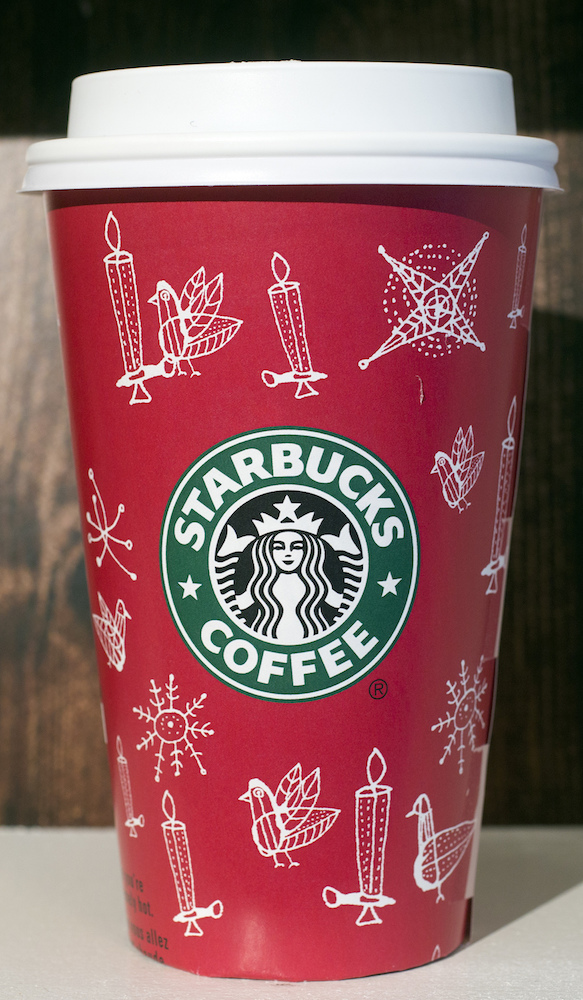 <div class='meta'><div class='origin-logo' data-origin='AP'></div><span class='caption-text' data-credit='AP Photo/Mark Lennihan'>A 2002 Starbucks holiday cup is displayed, Thursday, Nov. 9, 2017, at a Starbucks in New York. The Seattle-based company is celebrating 20 years of holiday coffee cups.</span></div>