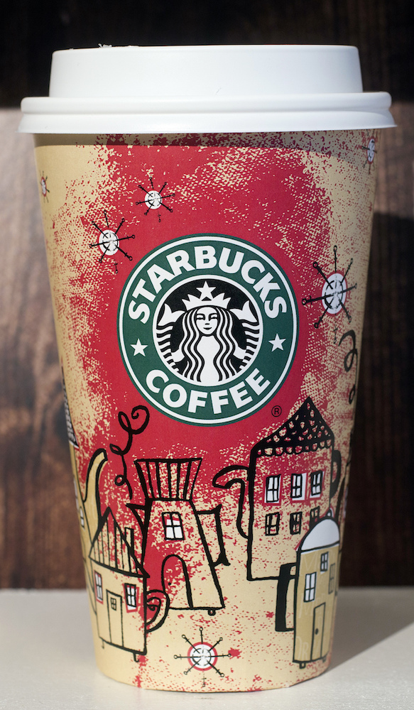 <div class='meta'><div class='origin-logo' data-origin='AP'></div><span class='caption-text' data-credit='AP Photo/Mark Lennihan'>A 2000 Starbucks holiday cup is displayed, Thursday, Nov. 9, 2017, at a Starbucks in New York. The Seattle-based company is celebrating 20 years of holiday coffee cups.</span></div>