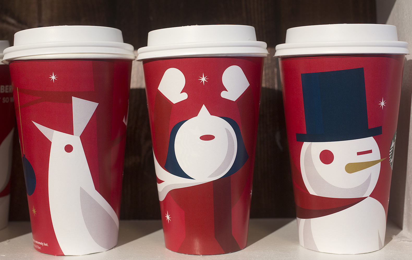 <div class='meta'><div class='origin-logo' data-origin='AP'></div><span class='caption-text' data-credit='AP Photo/Mark Lennihan'>Three Starbucks holiday cups from the 2012 holiday season are displayed, Thursday, Nov. 9, 2017, at a Starbucks in New York.</span></div>