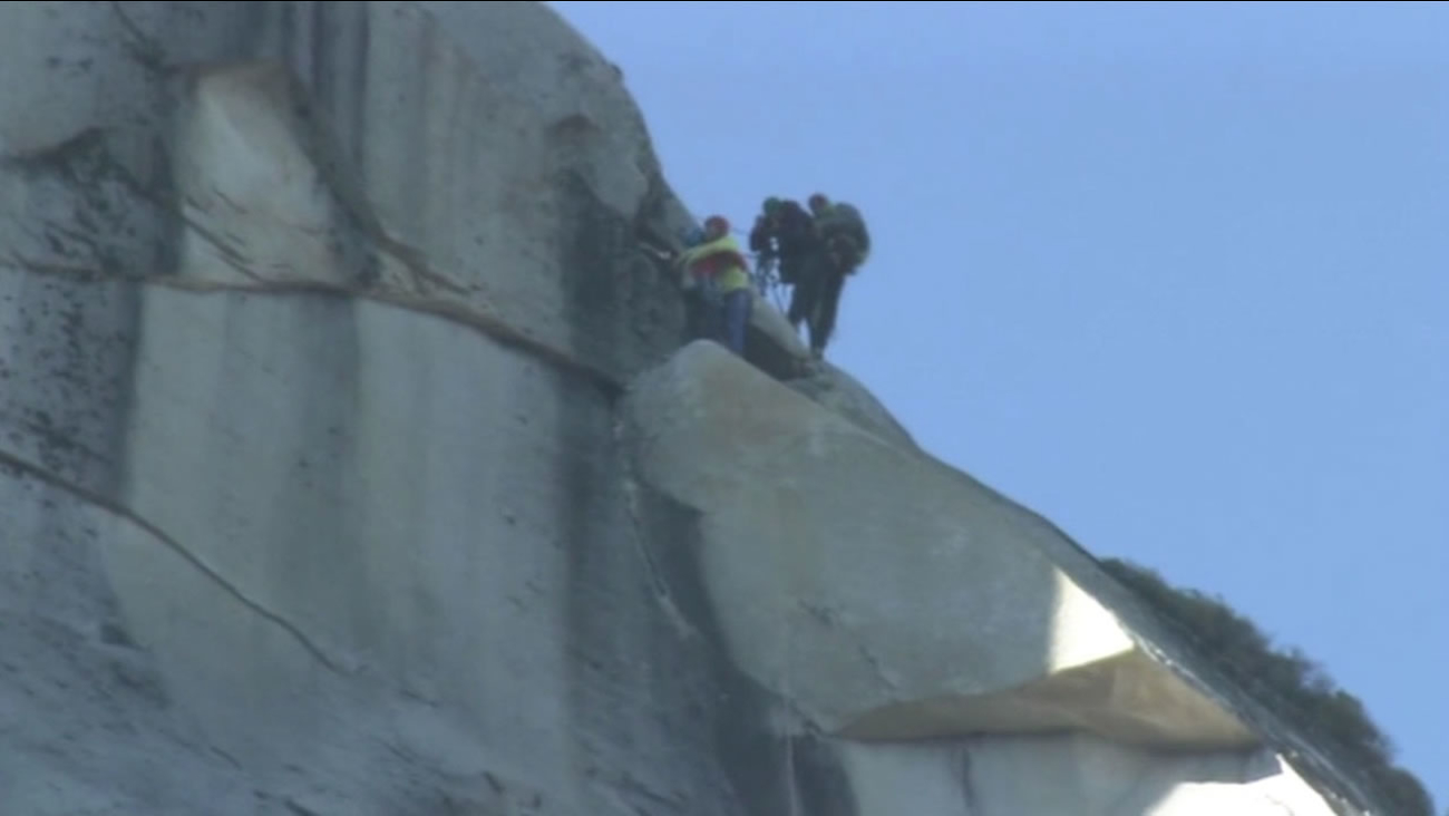 Tommy Caldwell and Kevin Jorgeson hugging at the summit