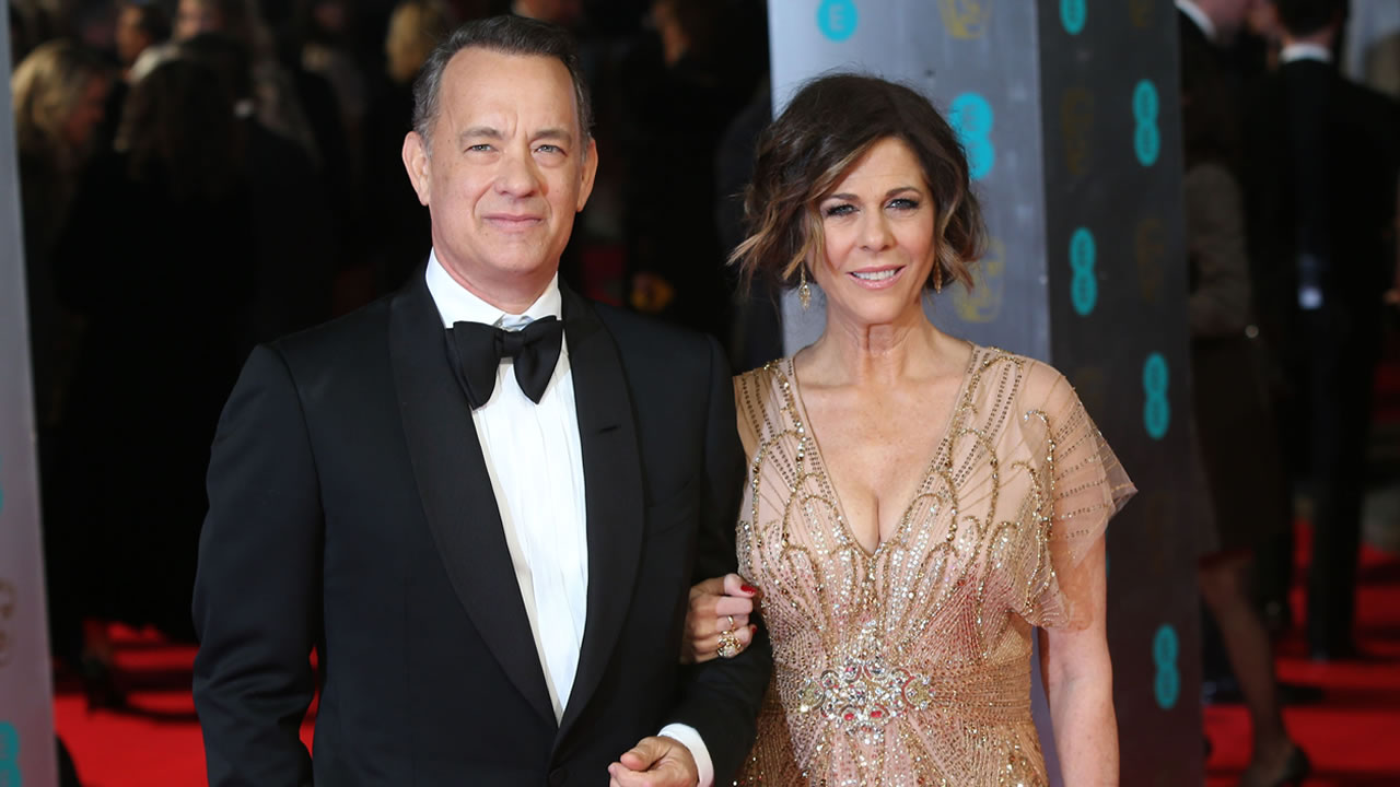 Actor Tom Hanks and his wife Rita Wilson pose for photographers on the red carpet at the EE British Academy Film Awards held at the Royal Opera House on Sunday Feb. 16, 2014, in London. (Photo by Joel Ryan/Invision/AP)