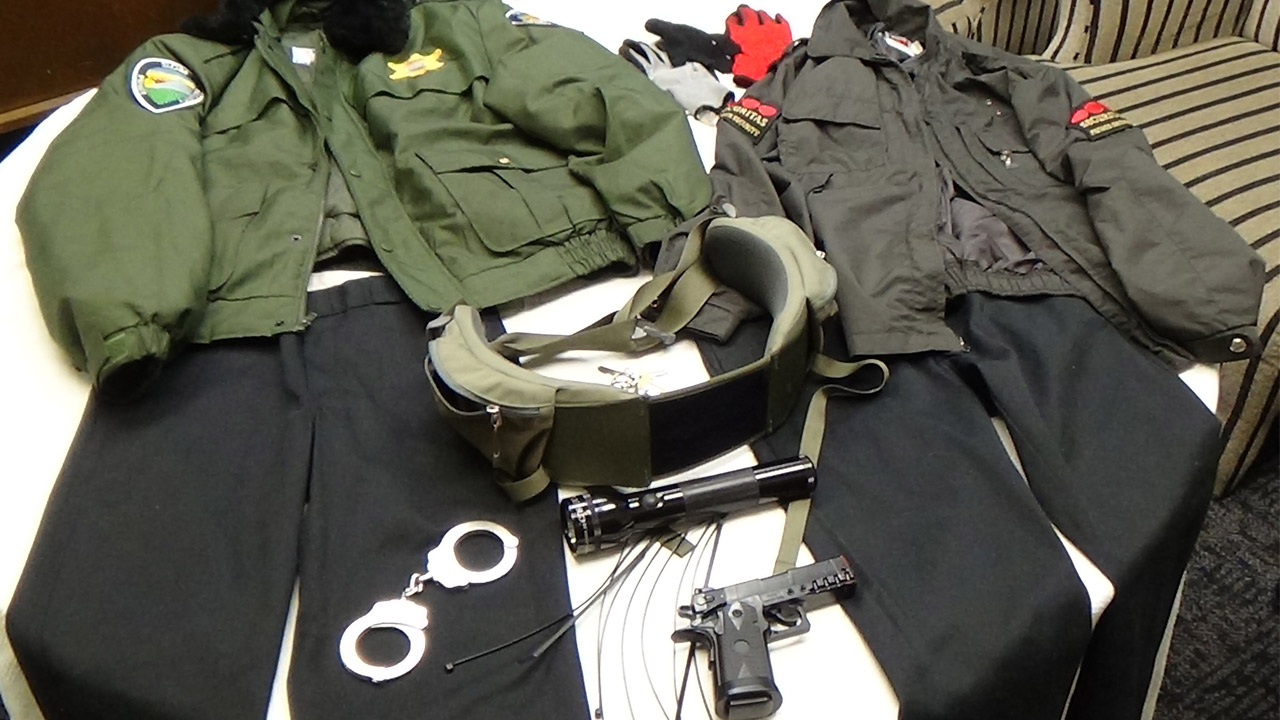 Carson Station Sheriff's detectives found two uniforms with police-like patches, a gun and handcuffs in the home of two women impersonating officers on Tuesday, Jan. 13, 2015.