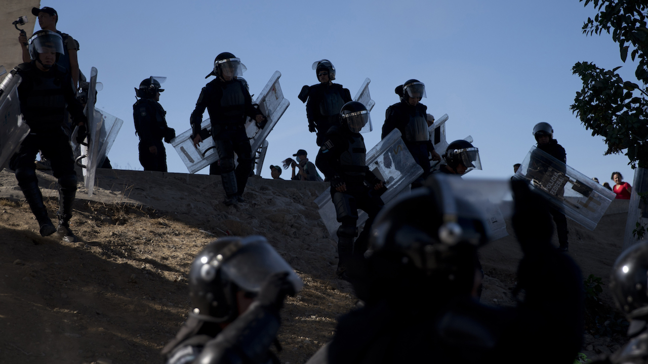 <div class='meta'><div class='origin-logo' data-origin='AP'></div><span class='caption-text' data-credit='AP Photo/Ramon Espinosa'>Mexican police spread out as they try to keep migrants from getting past the Chaparral border crossing in Tijuana, Mexico, Sunday, Nov. 25, 2018.</span></div>