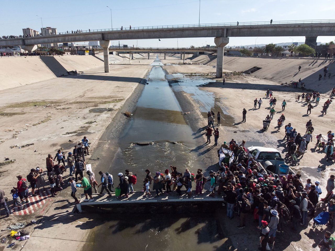 <div class='meta'><div class='origin-logo' data-origin='Creative Content'></div><span class='caption-text' data-credit='Guillermo Arias/AFP/Getty Images'>A group of Central American migrants crosses the almost-dry riverbed of the Tijuana River in an attempt to get to El Chaparral port of entry in Tijuana.</span></div>
