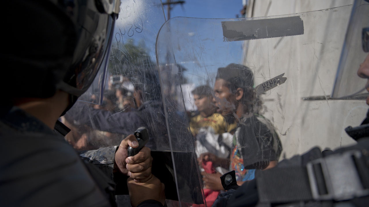 <div class='meta'><div class='origin-logo' data-origin='AP'></div><span class='caption-text' data-credit='AP Photo/Ramon Espinosa'>Mexican police try to keep migrants from advancing toward the Chaparral border crossing in Tijuana, Mexico, Sunday, Nov. 25, 2018, near the San Ysidro entry point into the U.S.</span></div>