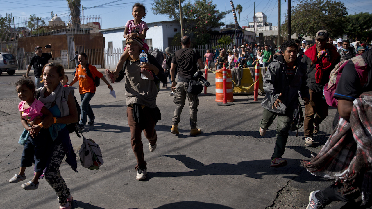 <div class='meta'><div class='origin-logo' data-origin='AP'></div><span class='caption-text' data-credit='AP Photo/Ramon Espinosa'>Migrants run toward the U.S. after breaking past a line of Mexican police at the Chaparral border crossing in Tijuana, Mexico, Nov. 25, 2018, near the San Ysidro entry point.</span></div>