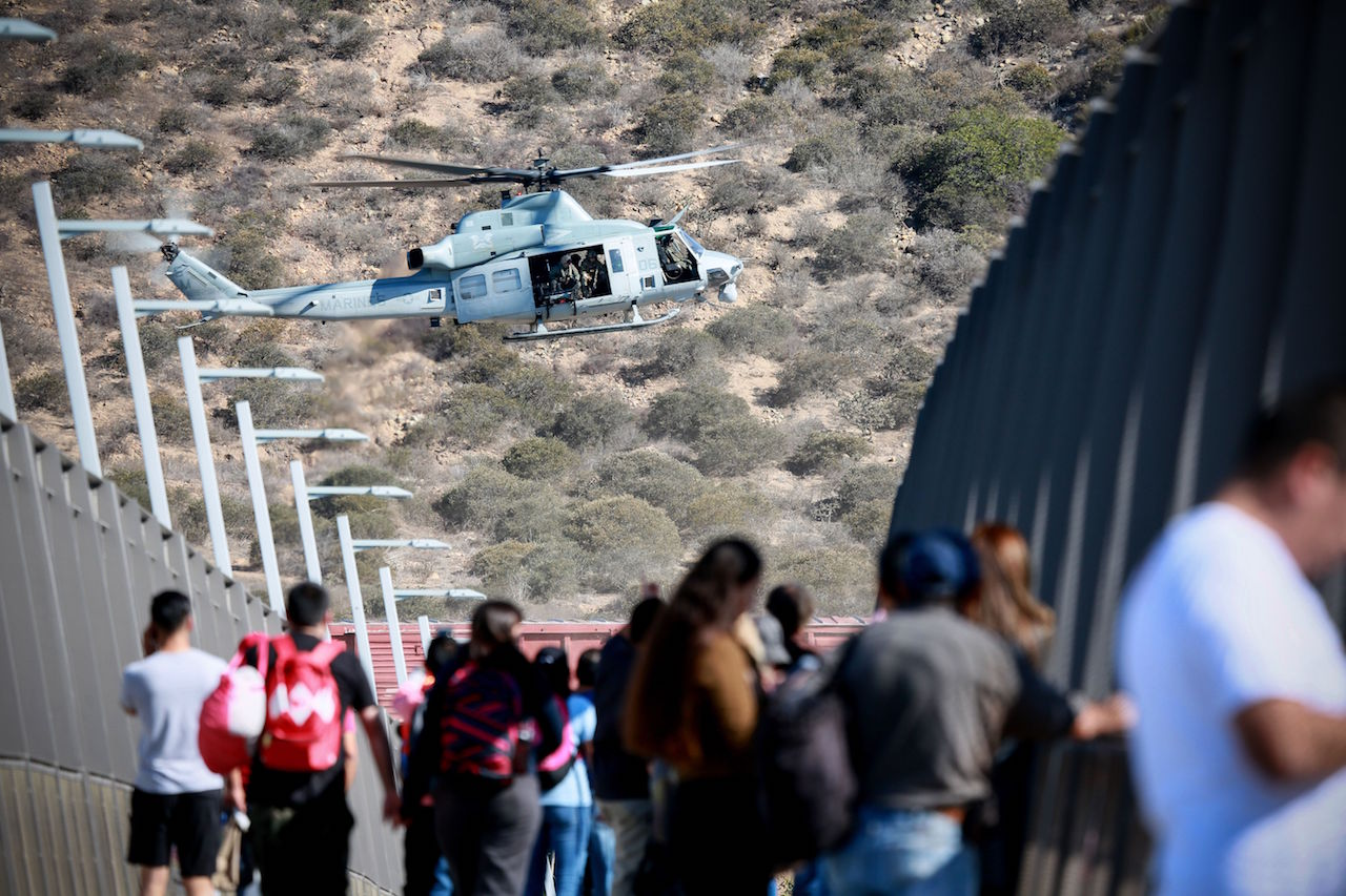 <div class='meta'><div class='origin-logo' data-origin='Creative Content'></div><span class='caption-text' data-credit='Sandy Huffaker/AFP/Getty Images'>A United States Military helicopter flies past a pedestrian bridge after the closing of the US-Mexico border was ordered on November 25, 2018, at the San Ysidro border crossing.</span></div>