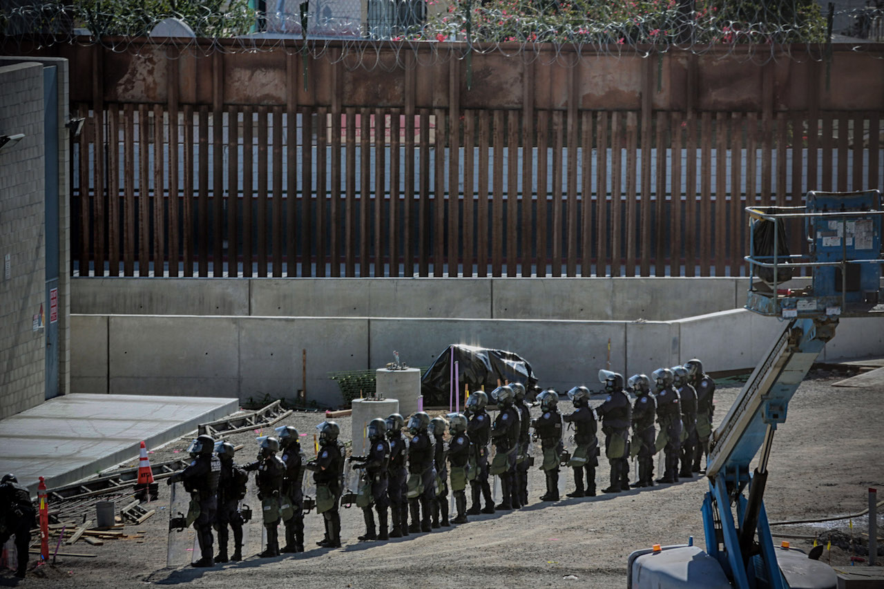 <div class='meta'><div class='origin-logo' data-origin='Creative Content'></div><span class='caption-text' data-credit='Sandy Huffaker/AFP/Getty Images'>United States Border Patrol agents secure the United States-Mexico border on November 25, 2018, at the San Ysidro border crossing point south of San Diego, California.</span></div>