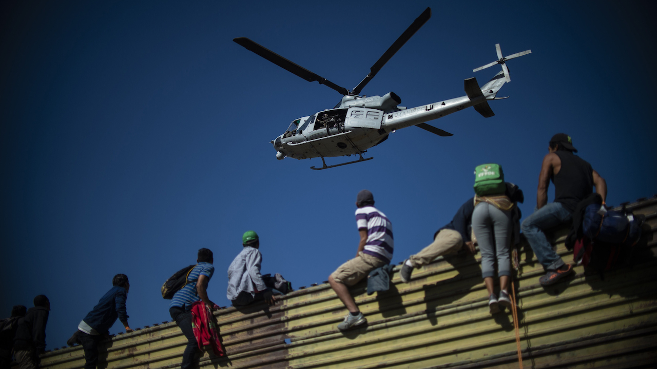 <div class='meta'><div class='origin-logo' data-origin='Creative Content'></div><span class='caption-text' data-credit='Pedro Pardo/AFP/Getty Images'>A group of Central American migrants climbs the border fence between Mexico and the United States, near El Chaparral border crossing, in Tijuana, Baja California State, Mexico.</span></div>